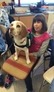 Therapy dog volunteer with girl
